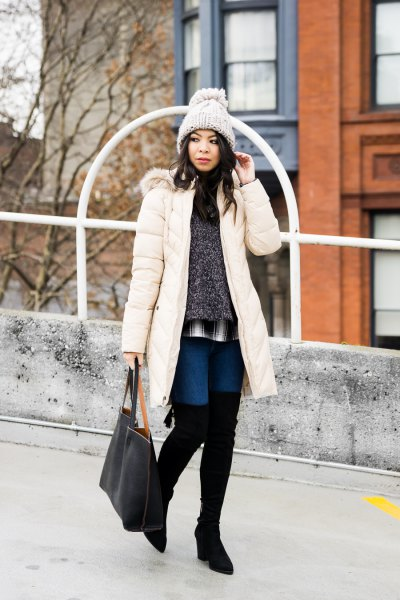 white long puffer coat with heather grey sweater and blue flowy shorts