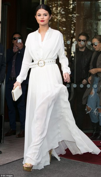 white long sleeve floor length flared dress with matching belt