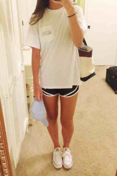 white oversized tee with black running shorts