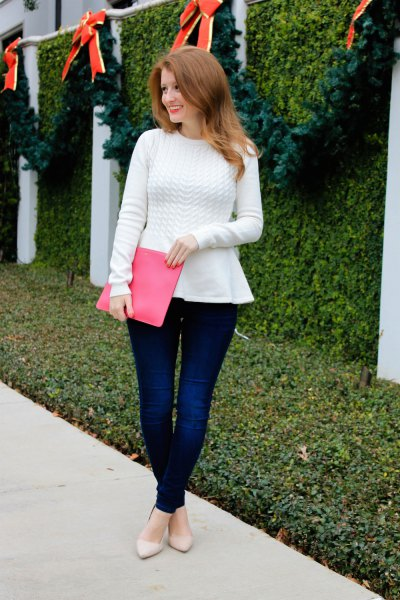 white peplum sweater with pink clutch bag