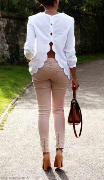 white scalloped cutout back with pink skinny jeans