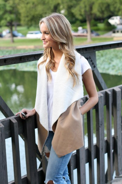 white shearling vest with t shirt and jeans