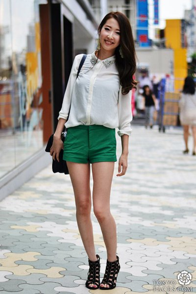 white shirt with sequin collar and green chino shorts