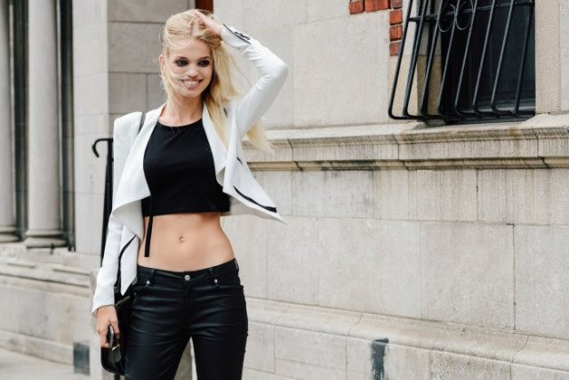 white short blazer with black crop top and leather pants