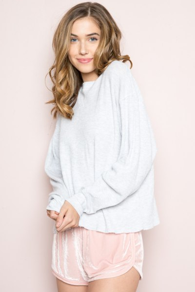 white sweater with blush pink mini silk shorts
