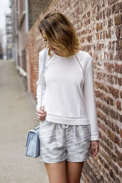 white sweater with flowy silver metallic shorts