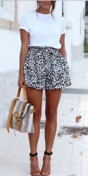 white t shirt with black leopard print shorts