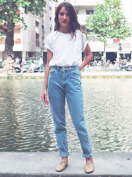 white t shirt with blue cuffed vintage high waisted jeans