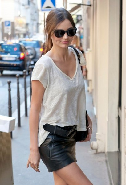 white textured v neck t shirt with black mini leather shorts
