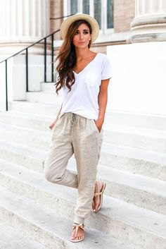 white v neck shirt with pale pink linen elastic waist pants