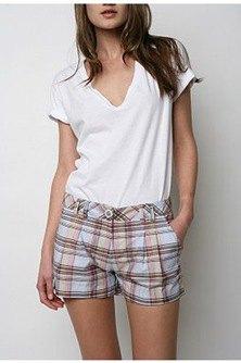 white v neck t shirt with pale blue plaid mini shorts
