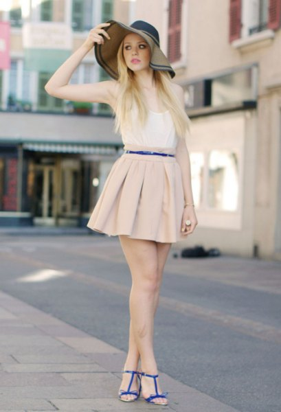 white vest top and pale pink mini pleated skirt