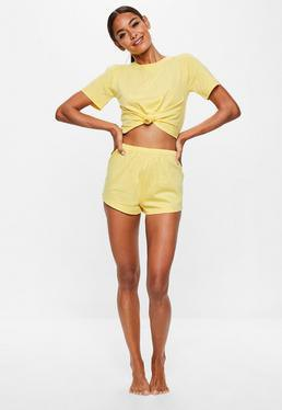 yellow knotted t shirt with mini shorts