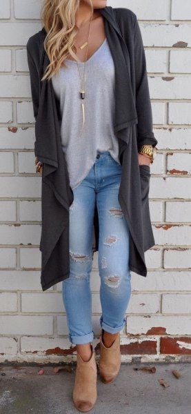Low cut tee with dark grey sweater coat and ripped jeans