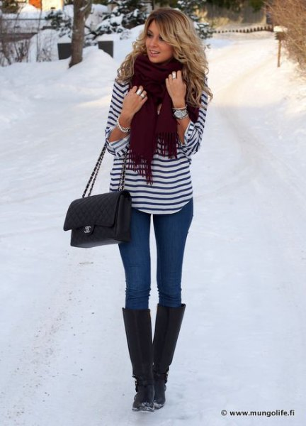 black and white striped long sleeve tee with blue jeans and snow boots