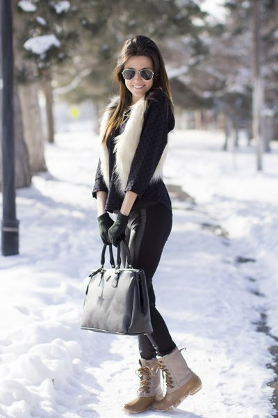 black blouse with faux fur vest and white snow boots