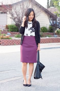 black cardigan with white printed sweater and purple pencil skirt
