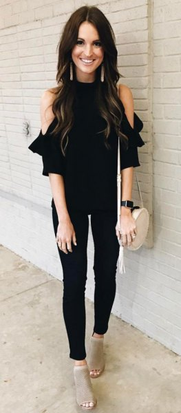 black cold shoulder blouse with skinny jeans and open toe boots