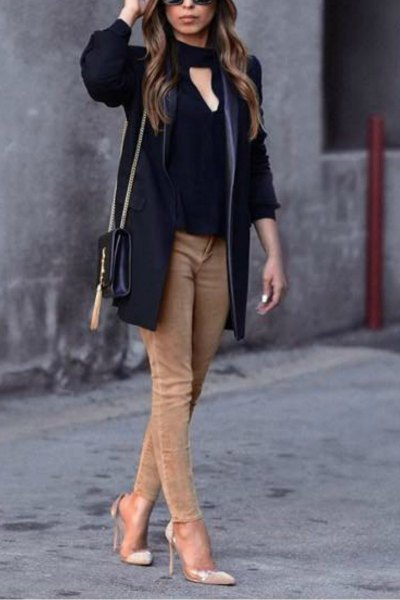 black cutout front blouse with light brown skinny jeans