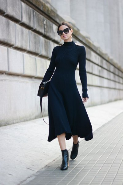 black form fitting flared midi dress with ankle boots