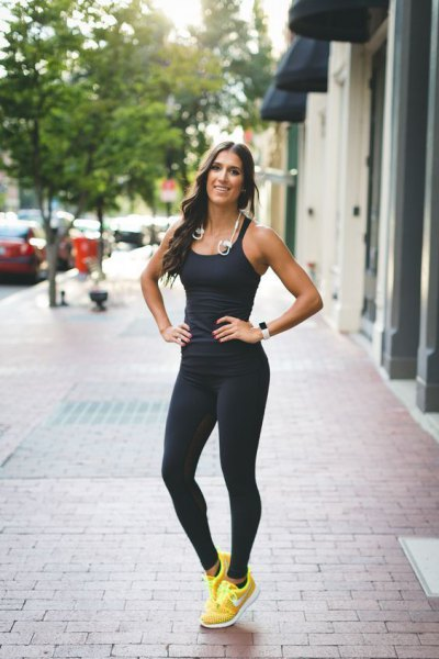 black form fitting vest top with running tights