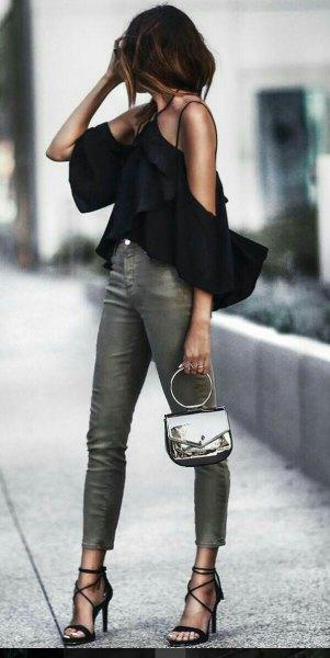 black halter neck cold shoulder ruffle blouse with grey skinny jeans