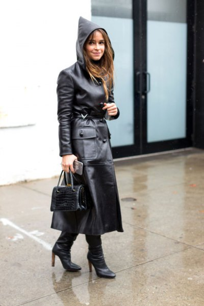 black hooded maxi leather trench coat with heeled boots