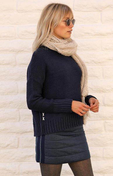 black knit sweater with dark grey down mini skirt