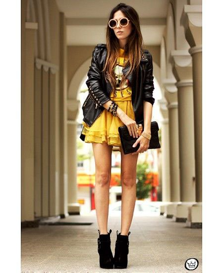 black leather jacket with mustard yellow mini multi layered dress
