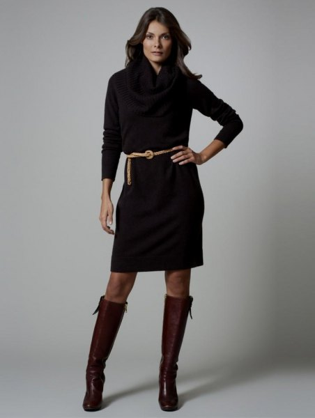 black long sleeve belted dress with knee high leather boots