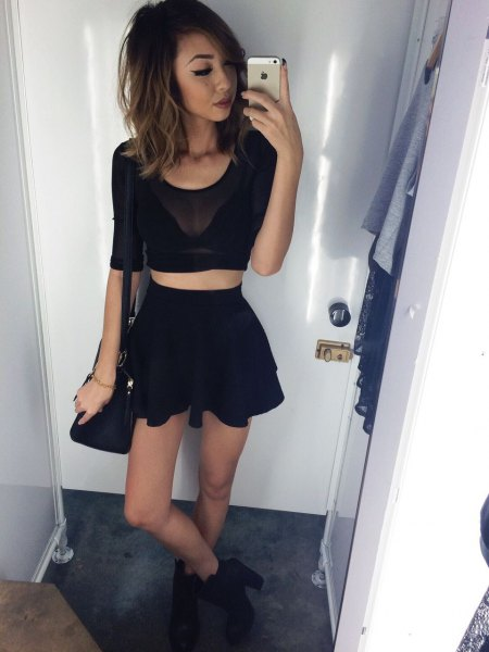 black mesh crop top with matching mini skater skirt