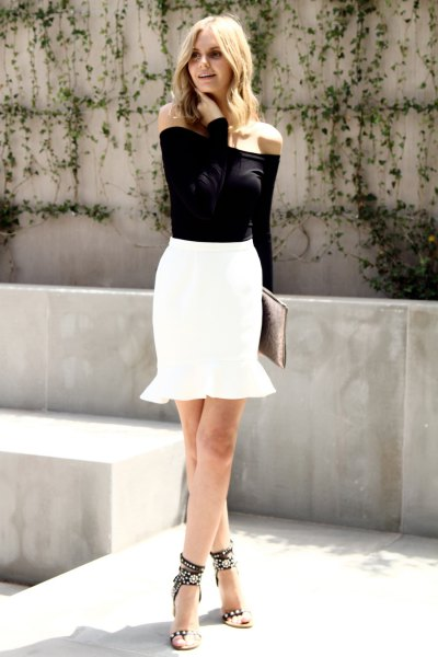 black off the shoulder blouse with white mini mermaid skirt