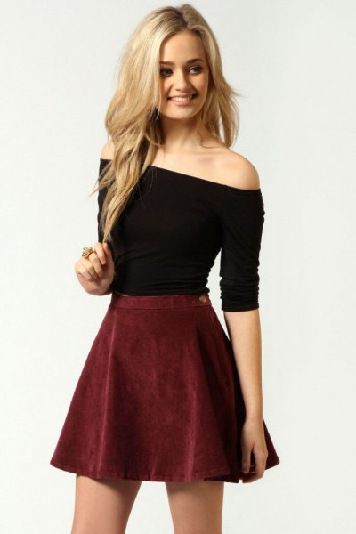 black off the shoulder form fitting top with burgundy suede skirt