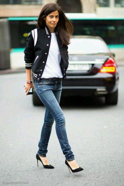 black satin bomber jacket with dark blue skinny jeans