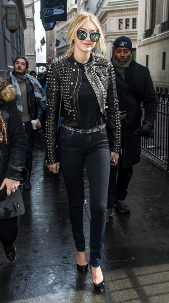 black studded leather jacket with matching belt and skinny jeans