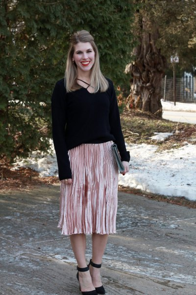 black sweater with rose gold midi pleated skirt