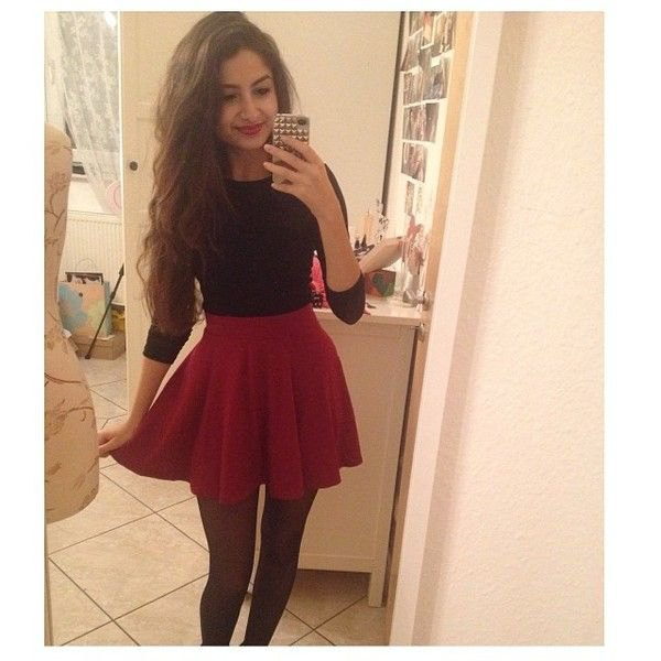 black three quarter sleeve sweater with red skater skirt