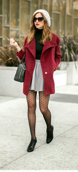 black turtleneck sweater and silver high waisted mini skirt