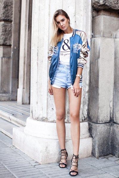 blue and white bomber jacket with mini denim shorts