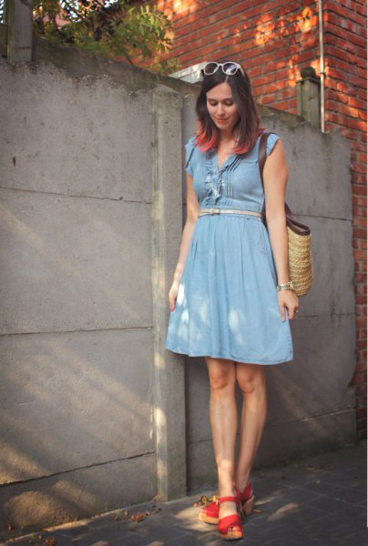 blue belted fit and flare knee length dress with red heels