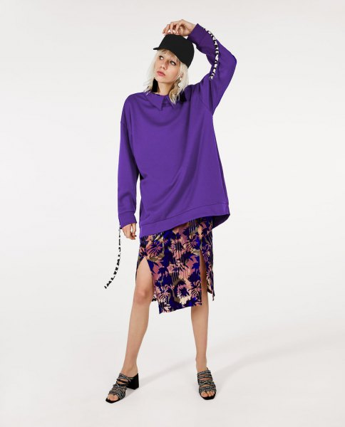 blue collared sweatshirt with navy printed chiffon midi skirt