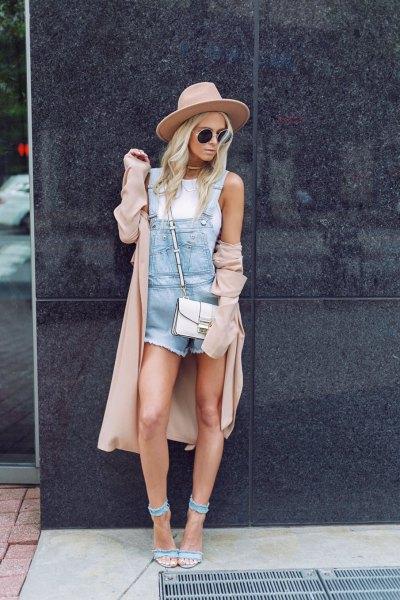 blue romper with longline blush coat and denim heels