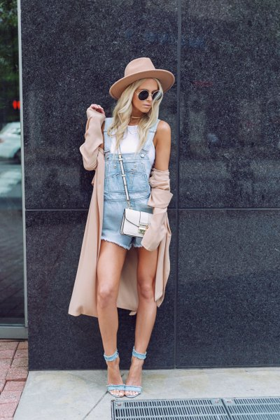 blue romper with longline blush coat and denim heels