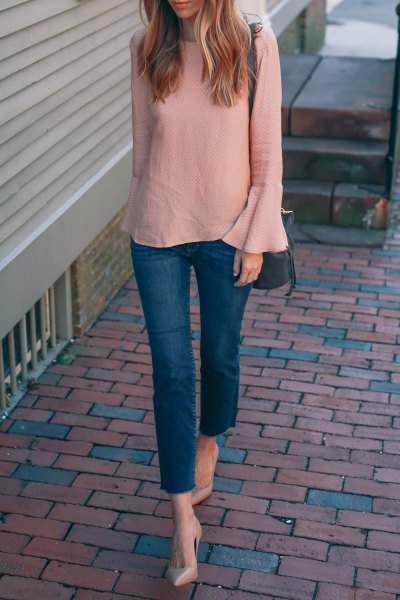 blush pink bell sleeve chiffon blouse with blue skinny ankle jeans
