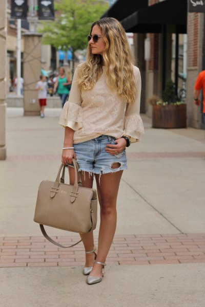 blush pink lace bell sleeve blouse with light blue ripped denim shorts