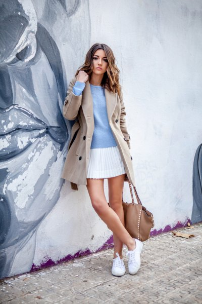 blush pink wool coat with light blue sweater and white mini pleated skirt