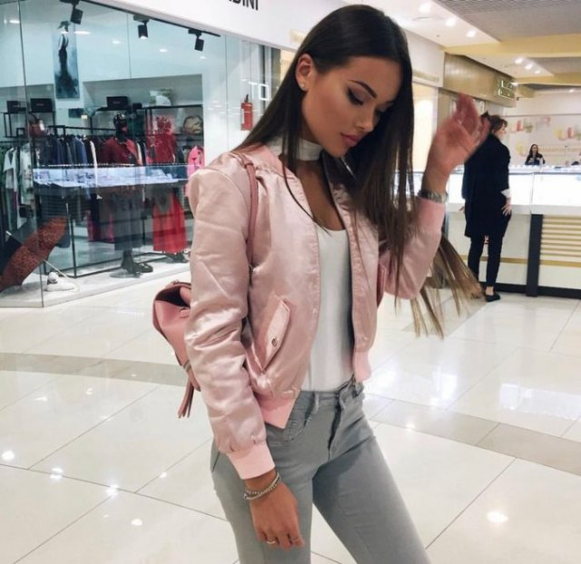 bomber jacket with white tank top and grey skinny jeans