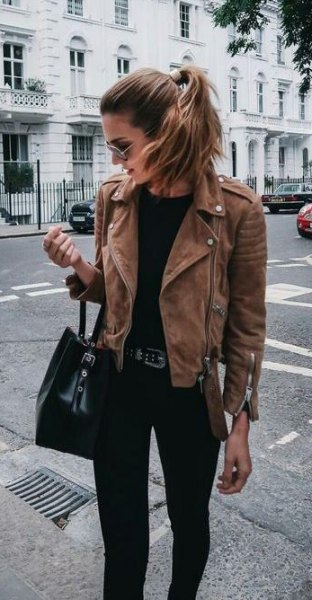 brown jacket with black purse and matching jeans