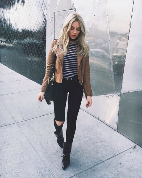brown jacket with striped long sleeve t shirt and black ripped jeans