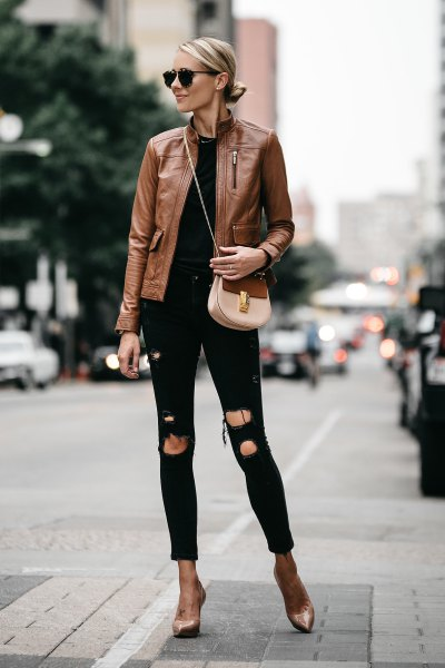 brown leather jacket with black ripped skinny jeans